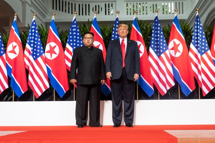 Kim_and_Trump_standing_next_to_each_other.jpg